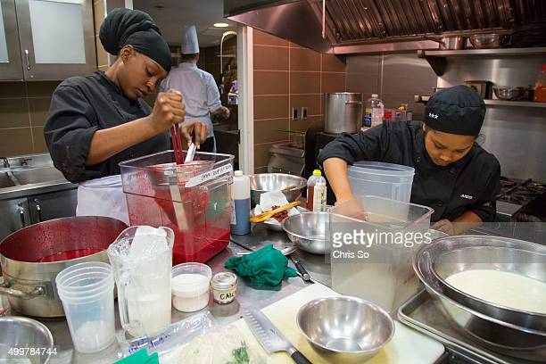 Toronto Ontario MARCH Thistletown Collegiate students are working in one of the kitchens of George Brown's Chef House restaurant From LR Nashambi...