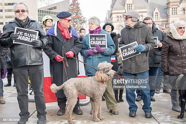 SQUARE TORONTO ONTARIO CANADA Toronto people meets in the Je Suis Charlie vigil at Nathan Phillips Square to honor the victims of the Charlie Hebdo...