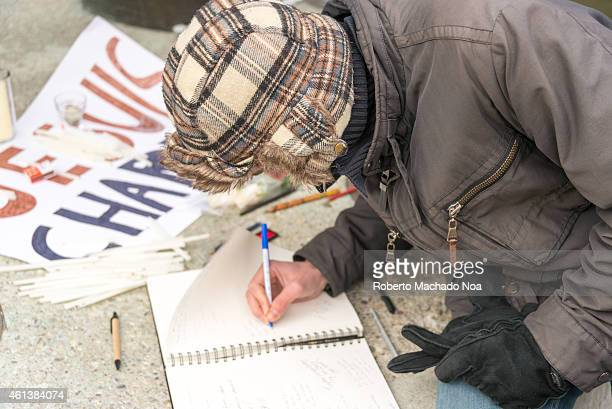 SQUARE TORONTO ONTARIO CANADA Toronto people sign condolences book in the Je Suis Charlie vigil at Nathan Phillips Square to honor the victims of the...
