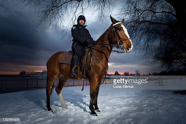 Toronto police horse Honest Ed and his rider Constable Rob Graham pose on the edge of Lake Ontario on January 2 2013 Honest Ed will be marching in...