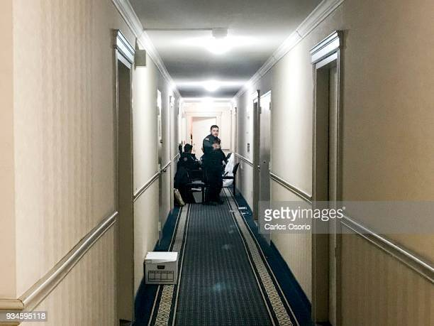 Toronto police officers are seen sitting in the hallway outside of Bruce McArthur's apartment located at 95 Thorncliffe Park Dr in Toronto