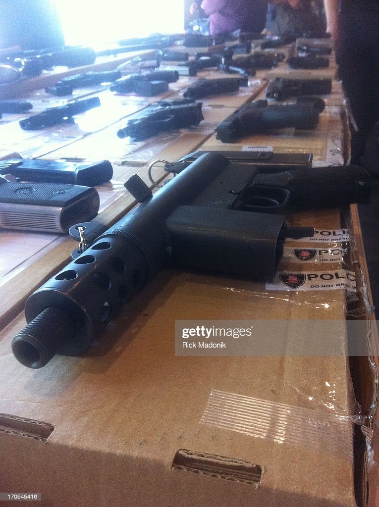 Toronto police show off guns and cash gathered over last year of Project Traveller.
