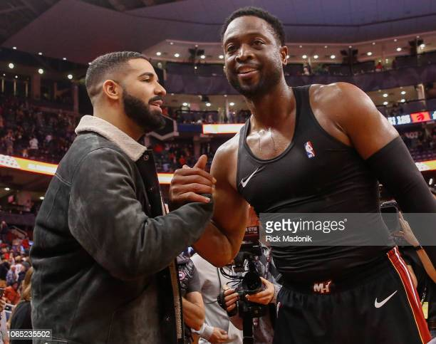Toronto rapper Drake says hello to Miami Heat guard Dwyane Wade following the game Toronto Raptors vs New Orleans Pelicans in 2nd half action of NBA...