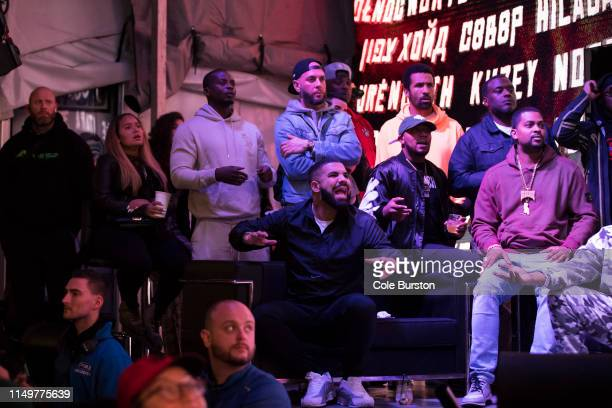 Toronto rapper Drake watches a screen alongside other Toronto Raptors fans as they gather to watch Game Six of the NBA Finals outside of Scotiabank...