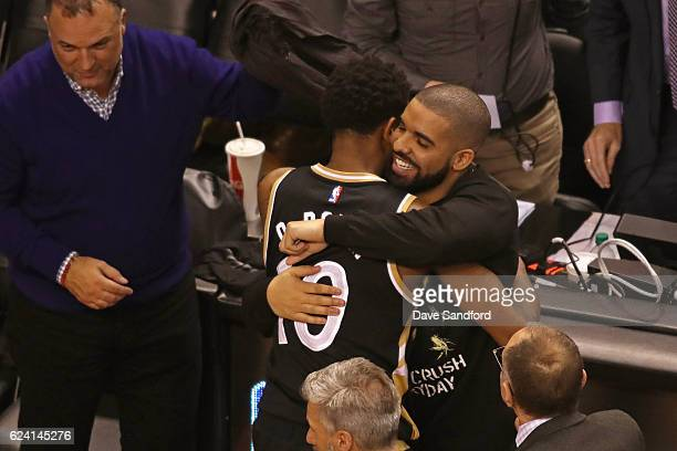 Toronto Raptors Ambassador and Performer Drake hugs DeMar DeRozan of the Toronto Raptors after the game against the Golden State Warriors at Air...
