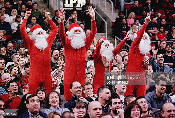Toronto Raptors' basketball fans get into the Christmas spirit dressed as Santa Claus during a game against the Los Angeles Lakers in 19 December...