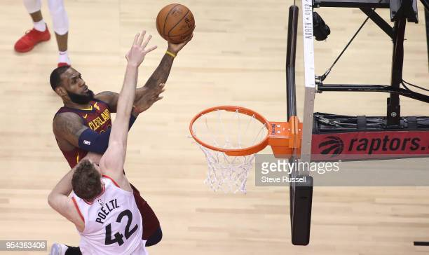 TORONTO ON MAY 3 Toronto Raptors center Jakob Poeltl defends against Cleveland Cavaliers forward LeBron James as the Toronto Raptors play the...
