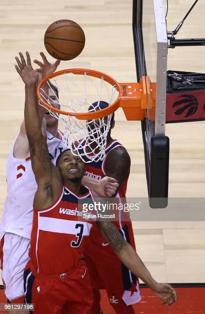 Toronto Raptors center Jakob Poeltl gets the ball over Washington Wizards guard Bradley Beal as the Toronto Raptors win game five of their first...