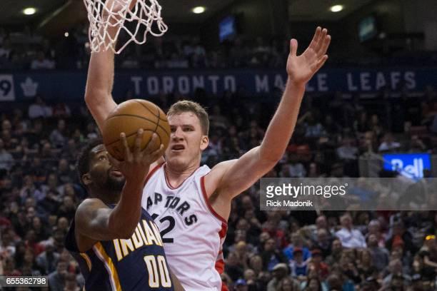 Toronto Raptors center Jakob Poeltl make his presence known on the baseline as Indiana Pacers guard Aaron Brooks tires to drive Toronto Raptors vs...