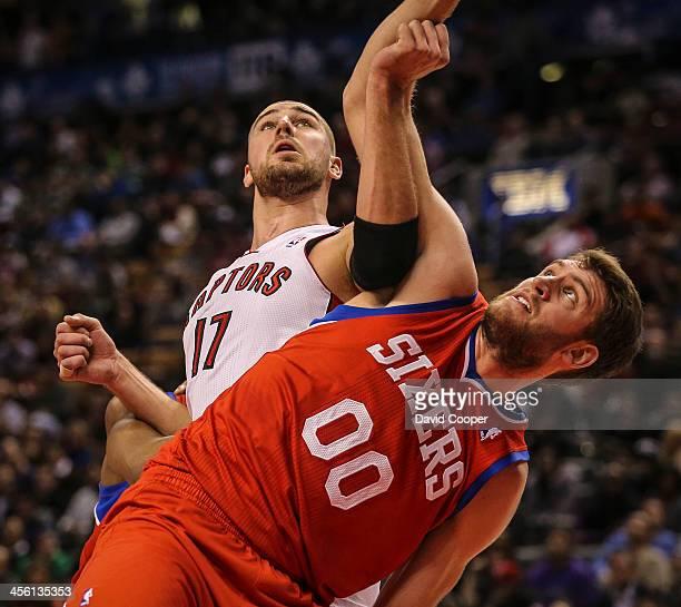 TORONTO ON DECEMBER 13 Toronto Raptors center Jonas Valanciunas and Philadelphia 76ers center Spencer Hawes fight for position under the hoop as...