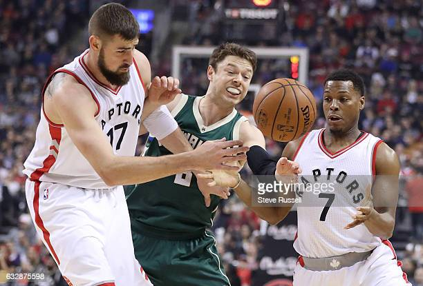 Toronto Raptors center Jonas Valanciunas and Toronto Raptors guard Kyle Lowry battle Milwaukee Bucks guard Matthew Dellavedova for a loose ball as...