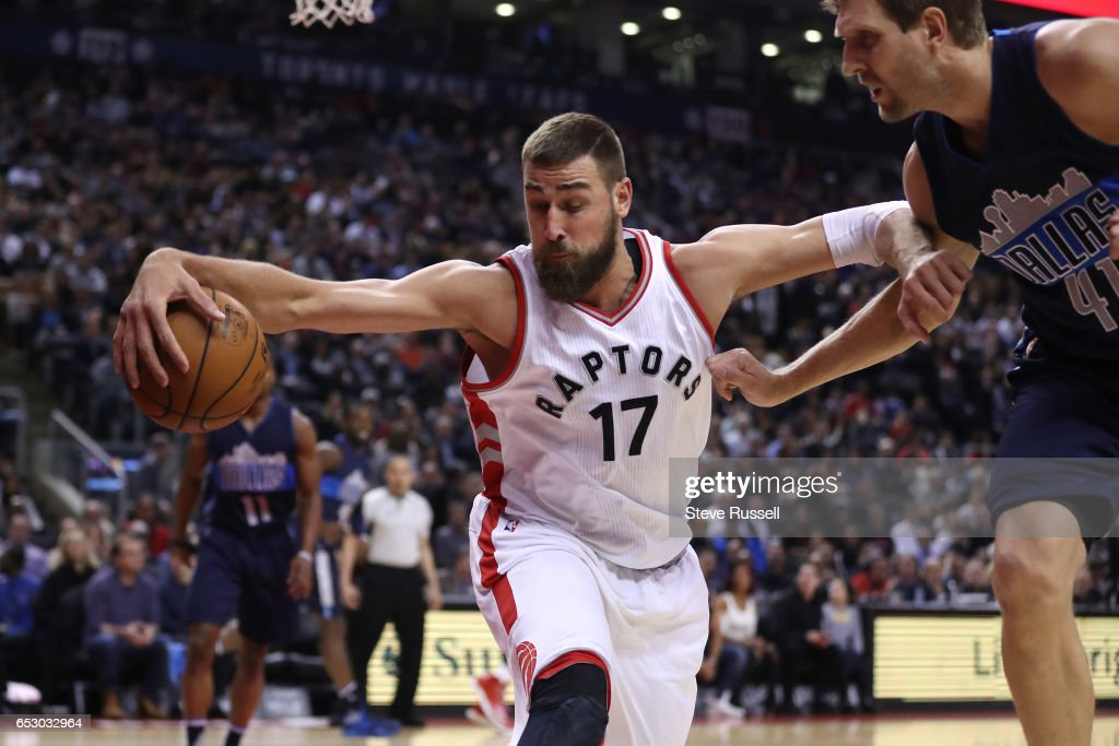 TORONTO, ON- MARCH 13 - Toronto Raptors center Jonas Valanciunas (17) beats Dallas Mavericks forward Dirk Nowitzki (41) to a loose ball as the Toronto Raptors play the Dallas Mavericks at the Air Canada Centre in Toronto. March 13, 2017.