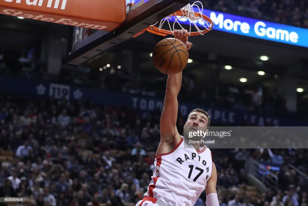 TORONTO, ON- MARCH 13 - Toronto Raptors center Jonas Valanciunas (17) dunks as the Toronto Raptors play the Dallas Mavericks at the Air Canada Centre in Toronto. March 13, 2017.