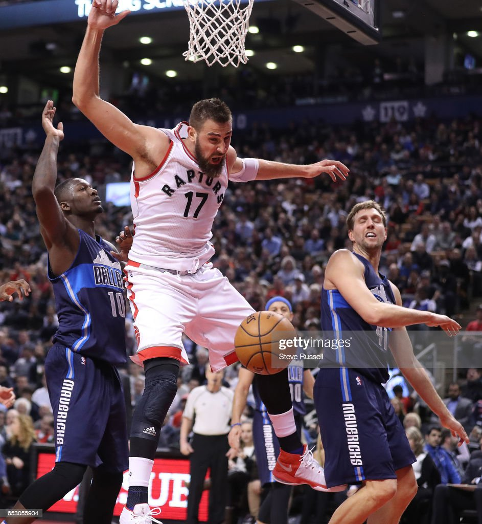 TORONTO, ON- MARCH 13 - Toronto Raptors center Jonas Valanciunas (17) is fouled by Dallas Mavericks forward Dorian Finney-Smith (10) as the Toronto Raptors beat the Dallas Mavericks 100-78 at the Air Canada Centre in Toronto. March 13, 2017.