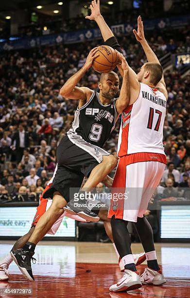TORONTO ON DECEMBER 10 Toronto Raptors center Jonas Valanciunas rejects San Antonio Spurs point guard Tony Parker under the basket as the San Antonio...