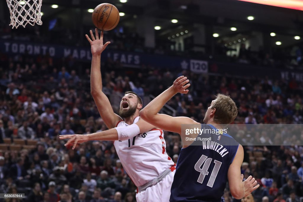 TORONTO, ON- MARCH 13 - Toronto Raptors center Jonas Valanciunas (17) scores two past Dallas Mavericks forward Dirk Nowitzki (41) as the Toronto Raptors play the Dallas Mavericks at the Air Canada Centre in Toronto. March 13, 2017.