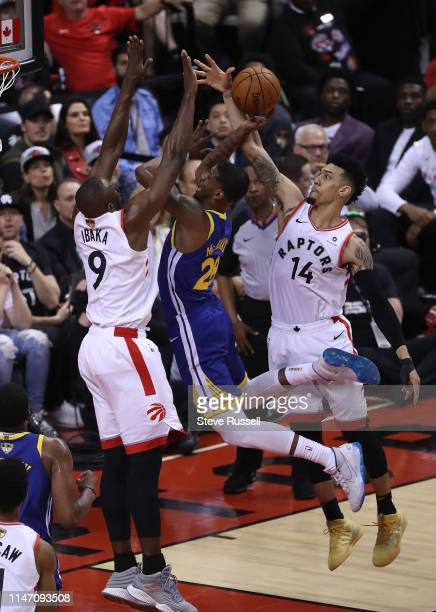 TORONTO ON MAY 30 Toronto Raptors center Serge Ibaka and Toronto Raptors guard Danny Green stop Golden State Warriors forward Alfonzo McKinnie as the...