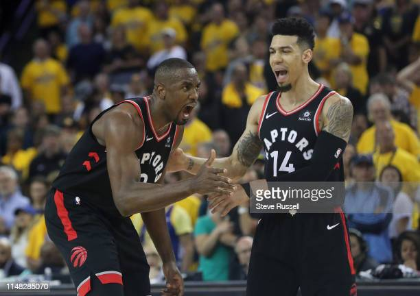 OAKLAND CA JUNE 5 Toronto Raptors center Serge Ibaka shouts for a shooting foul as Danny Green calms him as the Toronto Raptors beat the Golden State...