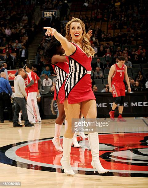 A Toronto Raptors cheerleader performs before a game against the Houston Rockets on April 2 2014 at the Air Canada Centre in Toronto Ontario Canada...