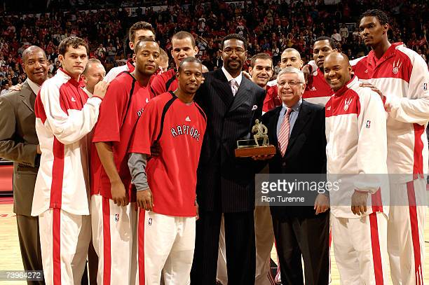Toronto Raptors coach Sam Mitchell accepts the Red Auerbach Trophy for 2006-07 NBA Coach of the Year from NBA Commissioner David Stern before Game...