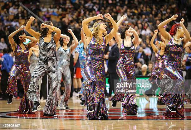 Toronto Raptors dance Pak performs during a break in the action during the game between the Toronto Raptors and the Washington Wizards Air Canada...