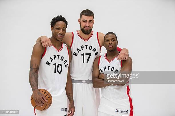 TORONTO ON SEPTEMBER 26 Toronto Raptors' DeMar DeRozan Jonas Valanciunas and Kyle Lowry pose for the camera during the team's media day at the...