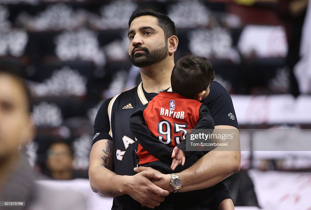 A Toronto Raptors fan and his son before the start of the game against the Indiana Pacers in Game One of the Eastern Conference Quarterfinals during the 2016 NBA Playoffs on April 16, 2016 at the Air Canada Centre in Toronto, Ontario, Canada.