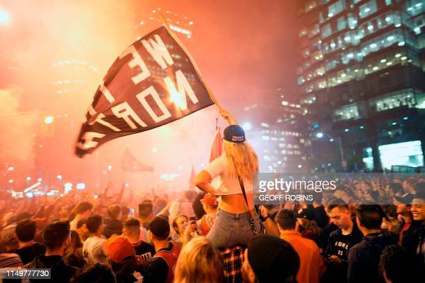 Toronto Raptors fans celebrate their win in the NBA championships in downtown Toronto Ontario on early June 14 2019