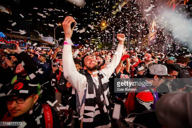 Toronto Raptors fans cheer after the Raptors defeat the Golden State Warriors in Game Six of the NBA Finals outside of Scotiabank Arena on June 13...