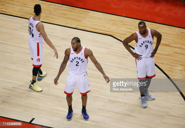 Toronto Raptors forward Kawhi Leonard and Toronto Raptors center Serge Ibaka and Toronto Raptors guard Danny Green don't agree with foul call on...