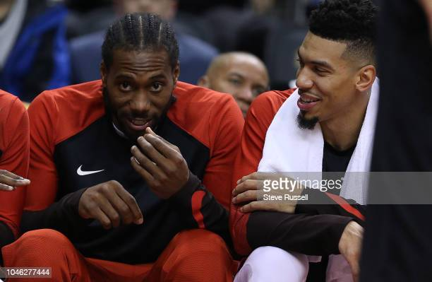 TORONTO ON OCTOBER 5 Toronto Raptors forward Kawhi Leonard and Toronto Raptors guard Danny Green talk on the bench as the Toronto Raptors play...