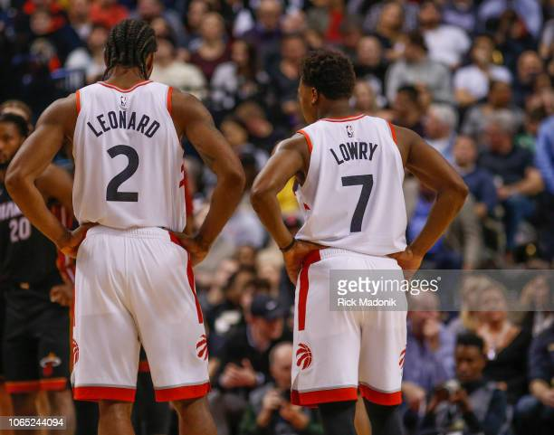 Toronto Raptors forward Kawhi Leonard and Toronto Raptors guard Kyle Lowry wait for the refs as they consult with each other Toronto Raptors vs New...