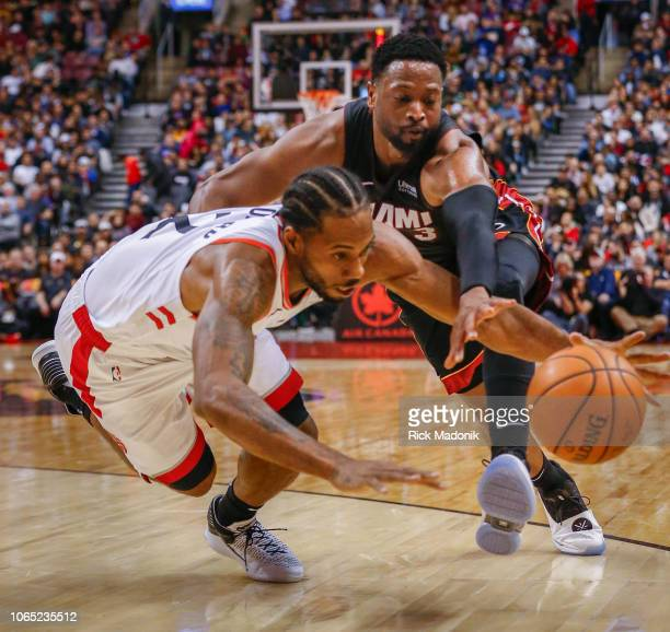 Toronto Raptors forward Kawhi Leonard causes Miami Heat guard Dwyane Wade to lose control of the ball and both would scramble after it Toronto...
