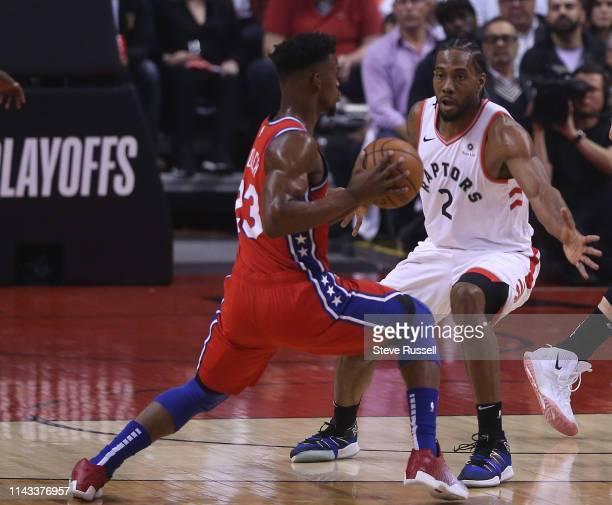 Toronto Raptors forward Kawhi Leonard defends Philadelphia 76ers guard Jimmy Butler as the Toronto Raptors beat the Philadelphia 76ers 92-90 in game...