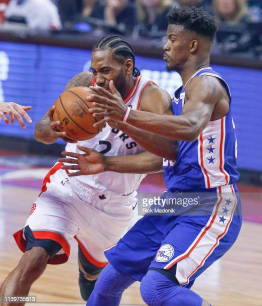 Toronto Raptors forward Kawhi Leonard goes against Philadelphia 76ers guard Jimmy Butler . Toronto Raptors vs Philadelphia 76ers in1st half action of...
