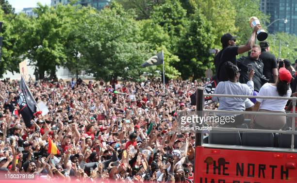 TORONTO ON JUNE 17 Toronto Raptors forward Kawhi Leonard hold up the MVP trophy as the Toronto Raptors hold their victory parade after beating the...