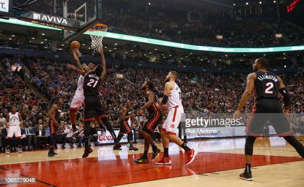 Toronto Raptors forward Kawhi Leonard is fouled by Miami Heat center Hassan Whiteside as he drives to the hoop Toronto Raptors vs New Orleans...