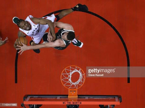 TORONTO ON MAY 21 Toronto Raptors forward Kawhi Leonard is fouled by Milwaukee Bucks center Brook Lopez as the Toronto Raptors beat the Milwaukee...