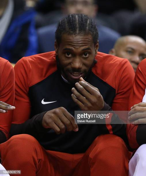 TORONTO ON OCTOBER 5 Toronto Raptors forward Kawhi Leonard laughs on the bench as the Toronto Raptors play Melbourne United in preseason basketball...