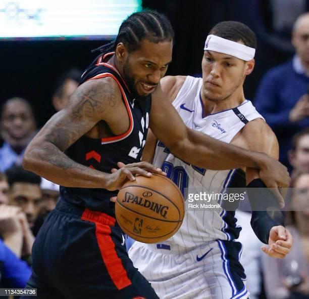 Toronto Raptors forward Kawhi Leonard looks to clear Orlando Magic forward Aaron Gordon out of his way as he heads to the hoop Toronto Raptors vs...