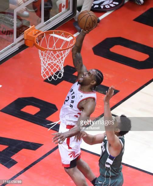 Toronto Raptors forward Kawhi Leonard lys in a shot in the final minutes as Milwaukee Bucks guard Eric Bledsoe defends as the Toronto Raptors play...