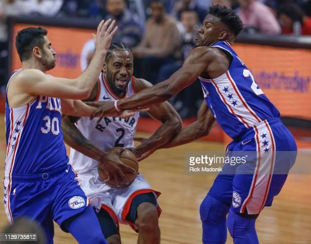 Toronto Raptors forward Kawhi Leonard splits the defence of Philadelphia 76ers guard Furkan Korkmaz and Philadelphia 76ers guard Jimmy Butler Toronto...