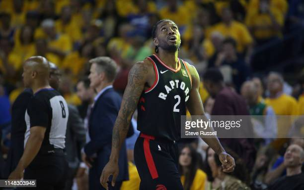 OAKLAND CA JUNE 5 Toronto Raptors forward Kawhi Leonard watches a replay as he walks into a time out as the Toronto Raptors beat the Golden State...