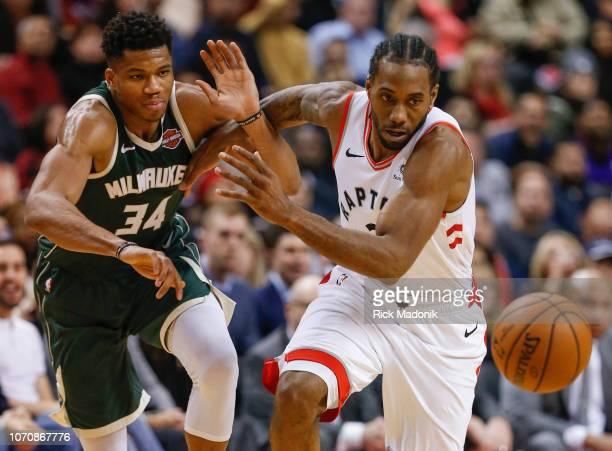 Toronto Raptors forward Kawhi Leonard with nice defence to deflect the ball away from Milwaukee Bucks forward Giannis Antetokounmpo and chase it down...