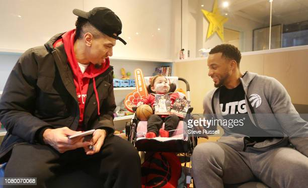 TORONTO ON JANUARY 10 Toronto Raptors forward Norman Powell smiles he and Toronto Raptors guard Danny Green visit Isabella Marcello who at 8...