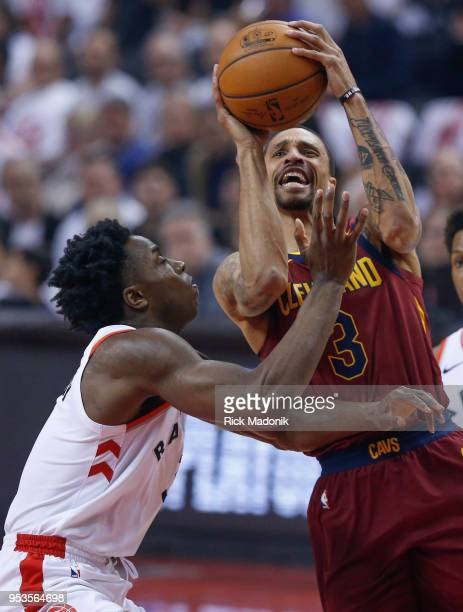 Toronto Raptors forward OG Anunoby tries to stop Cleveland Cavaliers guard George Hill Toronto Raptors vs Cleveland Cavaliers in 1st half action of...