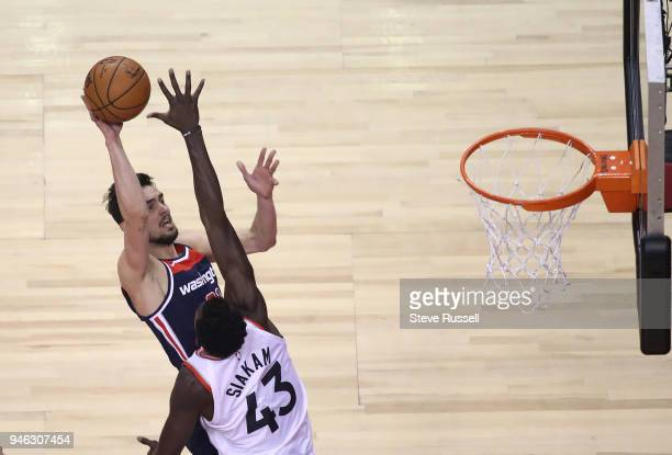 TORONTO ON APRIL 14 Toronto Raptors forward Pascal Siakam defends against Washington Wizards guard Tomas Satoransky as the Toronto Raptors open the...
