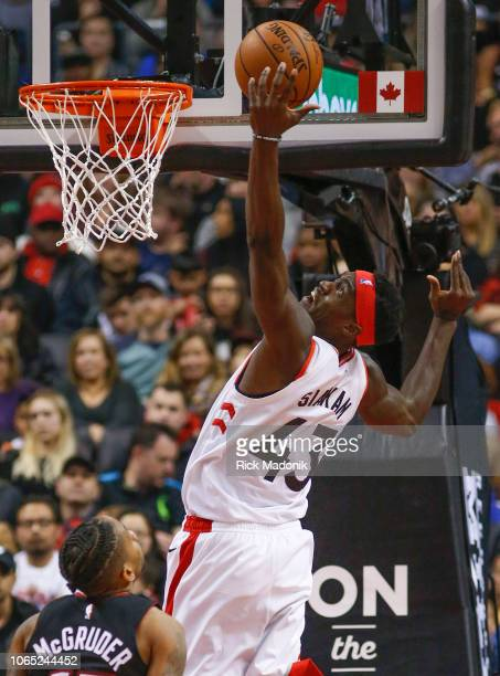 Toronto Raptors forward Pascal Siakam reaches back for a rebound Toronto Raptors vs New Orleans Pelicans in 1st half action of NBA regular season...
