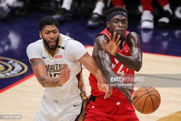 Toronto Raptors forward Pascal Siakam steals a pass intended for New Orleans Pelicans forward Anthony Davis on October 11 2018 at Smoothie King...