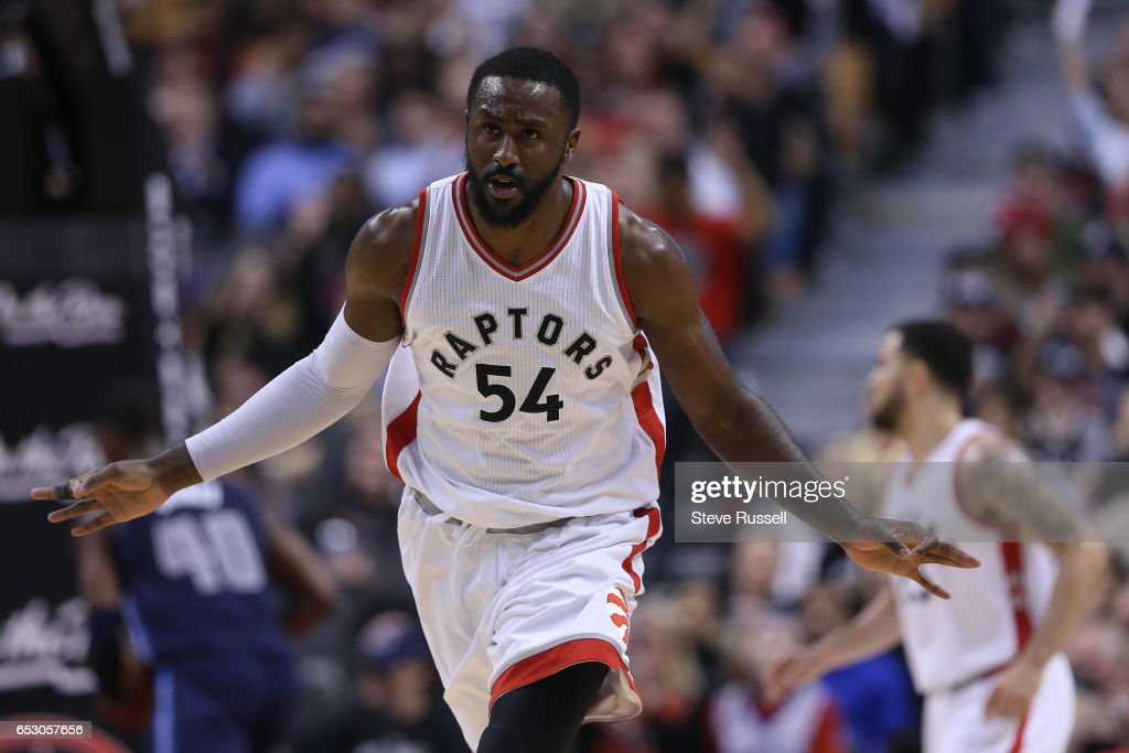 TORONTO, ON- MARCH 13 - Toronto Raptors forward Patrick Patterson (54) celebrates a three-pointer as the Toronto Raptors beat the Dallas Mavericks 100-78 at the Air Canada Centre in Toronto. March 13, 2017.